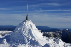 The summit cairn, skis and squidpole