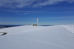 The summit of Mt Hotham looking back to the communications tower