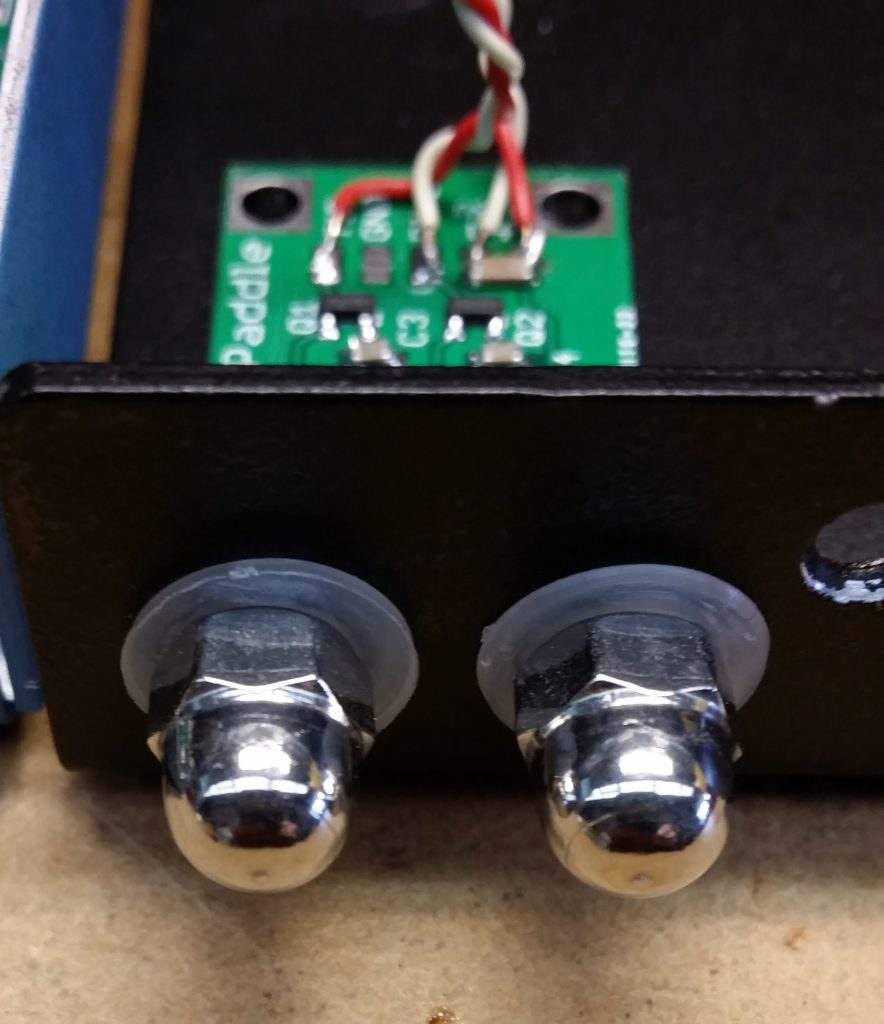 The contacts are made with stainless steel 5mm dome nuts insulated from the case with nylon washers