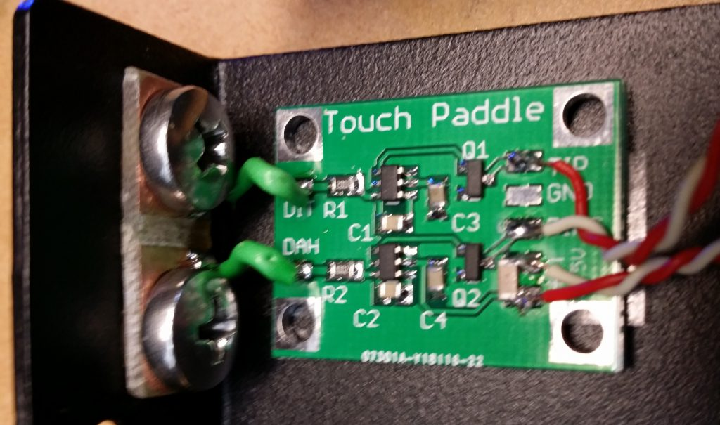 The paddle contacts are made from 5mm stainless steel screws and dome nuts. They are insulated from the case using a piece of PCB and nylon washers and bushings.
